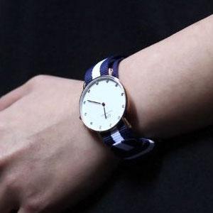 D W 0953DW 女款石英腕表 表径34mm